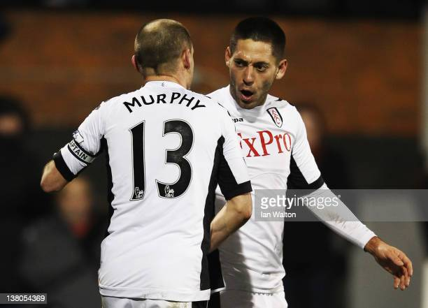 Clint Dempsey of Fulham celebrates with team mate Danny Murphy after scoring during the Barclays Premier League match between Fulham and West...