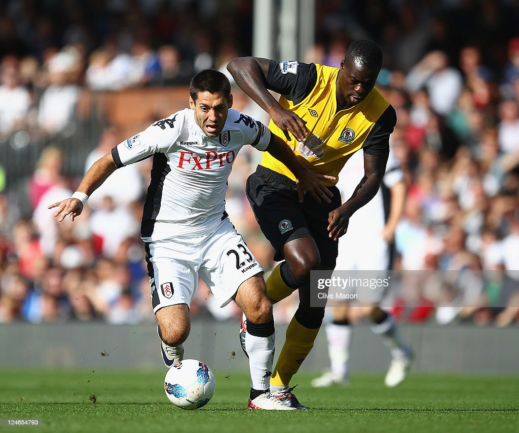<a gi-track='captionPersonalityLinkClicked' href=/galleries/search?phrase=Clint+Dempsey&family=editorial&specificpeople=547866 ng-click='$event.stopPropagation()'>Clint Dempsey</a> of Fulham holds off a challenge from <a gi-track='captionPersonalityLinkClicked' href=/galleries/search?phrase=Christopher+Samba&family=editorial&specificpeople=739114 ng-click='$event.stopPropagation()'>Christopher Samba</a> of Blackburn Rovers during the Barclays Premier League match between Fulham and Blackburn Rovers at Craven Cottage on September 11, 2011 in London, England.