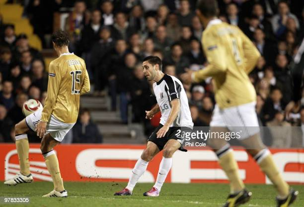 Clint Dempsey of Fulham shoots to score during the UEFA Europa League Round of 16 second leg match between Fulham and Juventus at Craven Cottage on...
