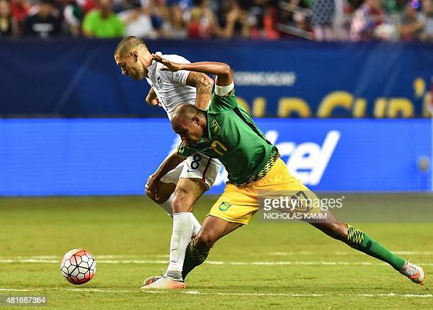 Clint Dempsey of he US vies with Jamaica's Rodolph Austin during a CONCACAF Gold Cup semifinal football match in Atlanta on July 22 2015 AFP...