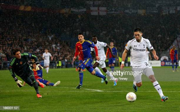 Clint Dempsey of Spurs rounds goalkeeper Yann Sommer of Basel to score the opening goal during UEFA Europa League quarter final second leg match...
