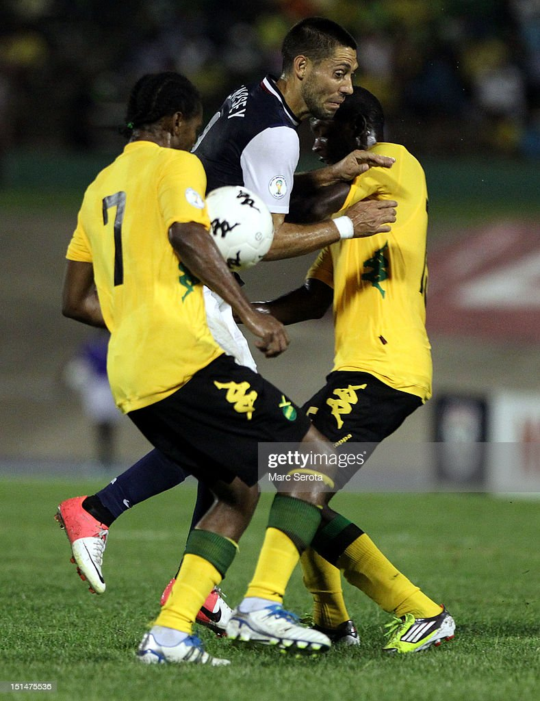 Clint Dempsey #8 of the United States battles for the ball with Jason Morrison #7 of Jamaica during the United States and Jamaica World Cup Qualifier at National Stadium on September 7, 2012 in Kingston, Jamaica.