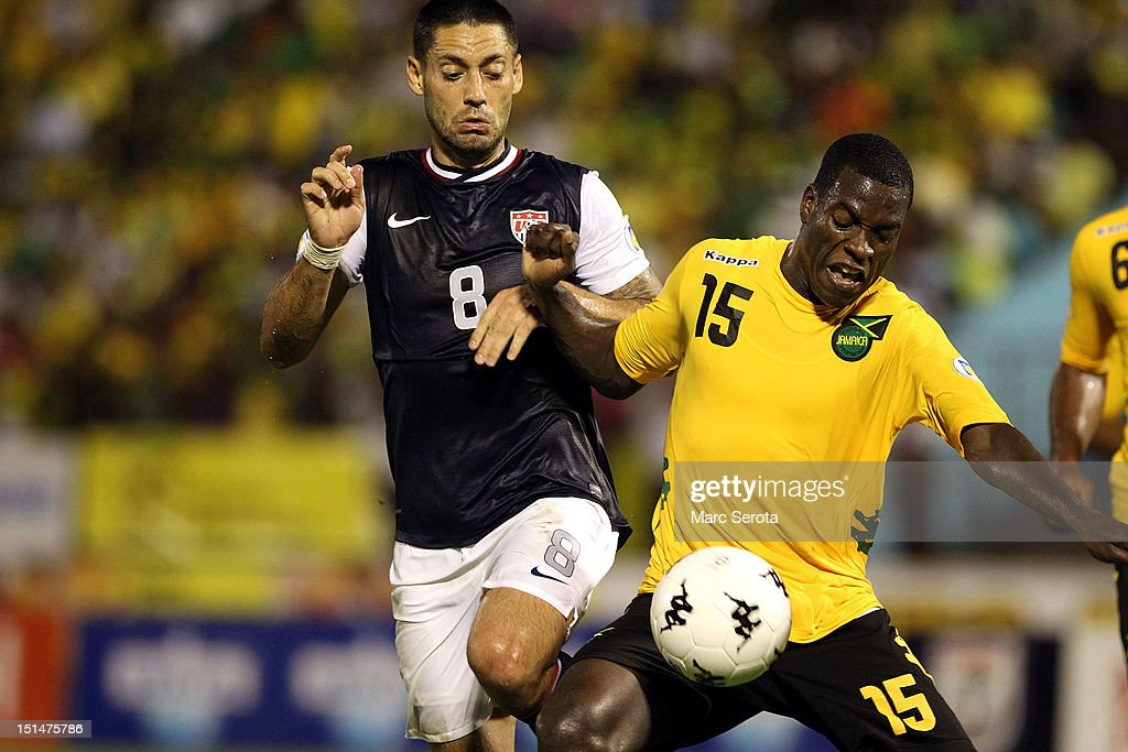 Clint Dempsey #8 of the United States battles for the ball with Je-Vaughn Watson #15 of Jamaica during the United States and Jamaica World Cup Qualifier at National Stadium on September 7, 2012 in Kingston, Jamaica.