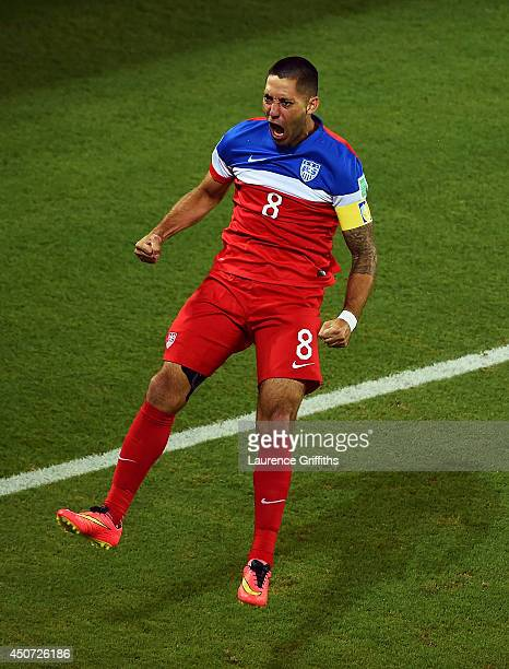 Clint Dempsey of the United States celebrates after scoring his team's first goal during the 2014 FIFA World Cup Brazil Group G match between Ghana...