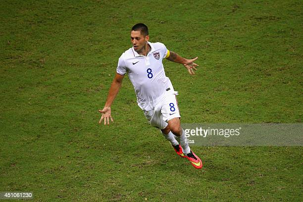 Clint Dempsey of the United States celebrates after scoring his team's second goal during the 2014 FIFA World Cup Brazil Group G match between the...