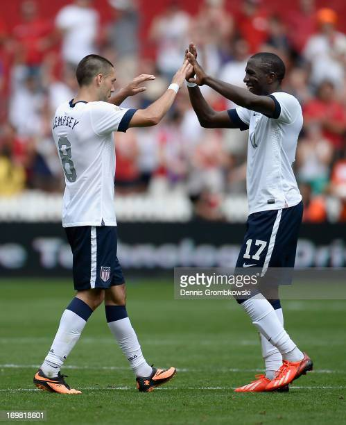 Clint Dempsey of the United States celebrates scoring his side's third goal with team mate Jozy Altidore during the International Friendly match...