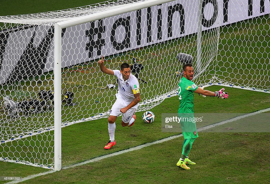 <a gi-track='captionPersonalityLinkClicked' href=/galleries/search?phrase=Clint+Dempsey&family=editorial&specificpeople=547866 ng-click='$event.stopPropagation()'>Clint Dempsey</a> of the United States celebrates scoring his team's second goal past <a gi-track='captionPersonalityLinkClicked' href=/galleries/search?phrase=<a gi-track='captionPersonalityLinkClicked' href=/galleries/search?phrase=Beto+-+Portuguese+Soccer+Goalie&family=editorial&specificpeople=5747462 ng-click='$event.stopPropagation()'>Beto</a>+-+Portuguese+Soccer+Central+Defender+-+Born+1976&family=editorial&specificpeople=2782161 ng-click='$event.stopPropagation()'><a gi-track='captionPersonalityLinkClicked' href=/galleries/search?phrase=Beto+-+Portuguese+Soccer+Goalie&family=editorial&specificpeople=5747462 ng-click='$event.stopPropagation()'>Beto</a></a> of Portugal during the 2014 FIFA World Cup Brazil Group G match between the United States and Portugal at Arena Amazonia on June 22, 2014 in Manaus, Brazil.