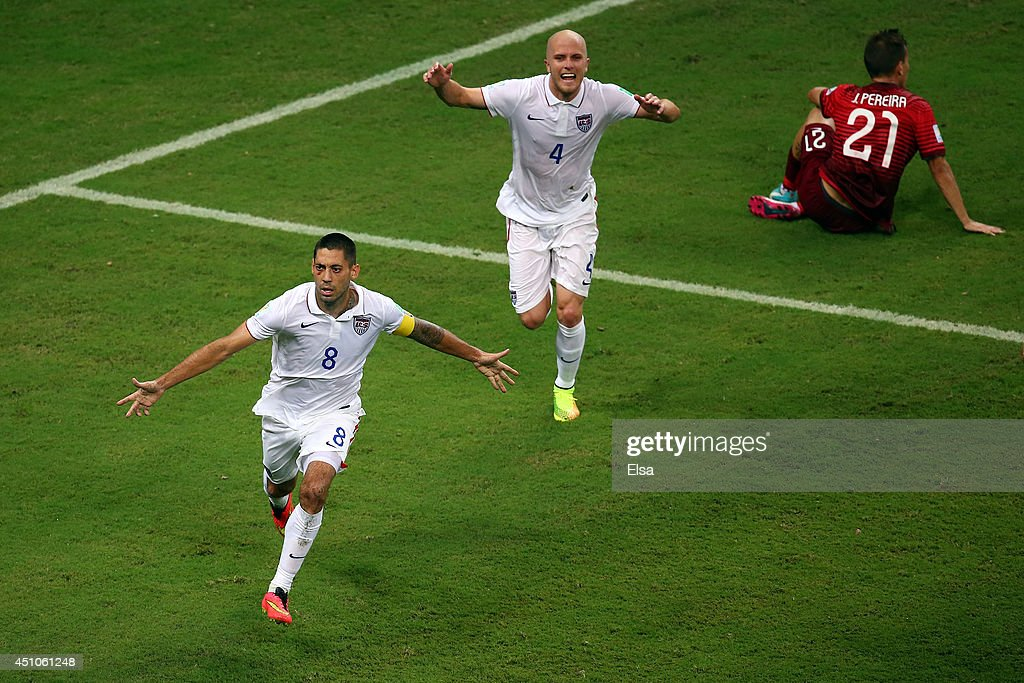 <a gi-track='captionPersonalityLinkClicked' href=/galleries/search?phrase=Clint+Dempsey&family=editorial&specificpeople=547866 ng-click='$event.stopPropagation()'>Clint Dempsey</a> of the United States celebrates scoring his team's second goal with teammate Michael Bradley as Joao Pereira of Portugal looks on during the 2014 FIFA World Cup Brazil Group G match between the United States and Portugal at Arena Amazonia on June 22, 2014 in Manaus, Brazil.