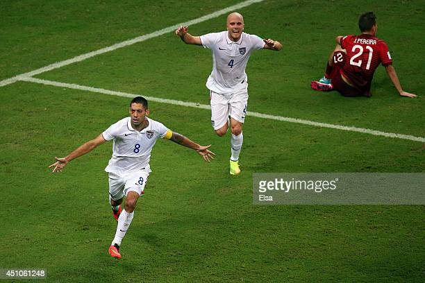Clint Dempsey of the United States celebrates scoring his team's second goal with teammate Michael Bradley as Joao Pereira of Portugal looks on...
