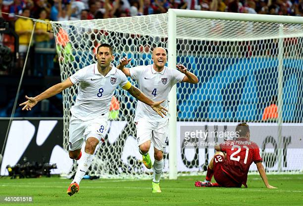 Clint Dempsey of the United States celebrates scoring his team's second goal during the 2014 FIFA World Cup Brazil Group G match between USA and...