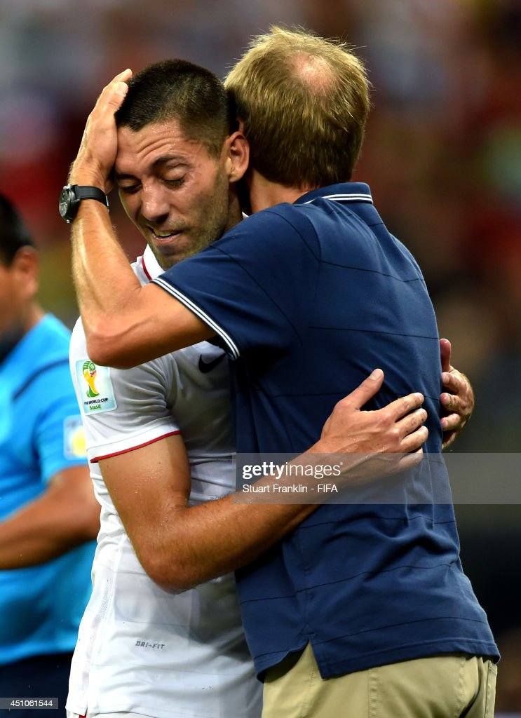 <a gi-track='captionPersonalityLinkClicked' href=/galleries/search?phrase=Clint+Dempsey&family=editorial&specificpeople=547866 ng-click='$event.stopPropagation()'>Clint Dempsey</a> of the United States celebrates scoring his team's second goal with head coach <a gi-track='captionPersonalityLinkClicked' href=/galleries/search?phrase=Jurgen+Klinsmann&family=editorial&specificpeople=228023 ng-click='$event.stopPropagation()'>Jurgen Klinsmann</a> during the 2014 FIFA World Cup Brazil Group G match between USA and Portugal at Arena Amazonia on June 22, 2014 in Manaus, Brazil.