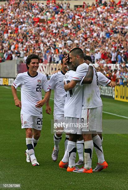 Clint Dempsey of the United States celebrates with teammates after scoring the game winning goal during a preWorld Cup warmup match against Turkey at...
