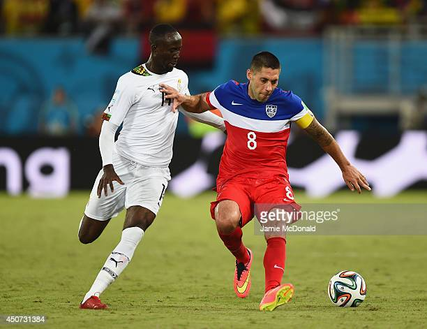 Clint Dempsey of the United States holds off a challenge by Albert Adomah of Ghana during the 2014 FIFA World Cup Brazil Group G match between Ghana...