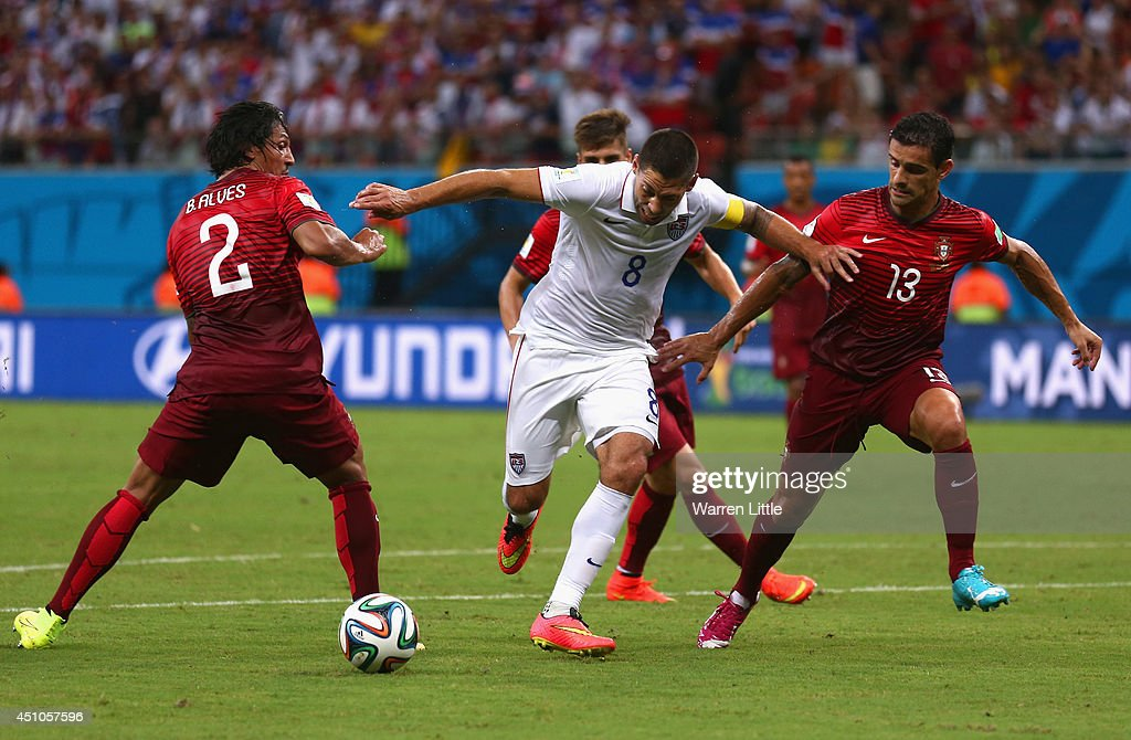 <a gi-track='captionPersonalityLinkClicked' href=/galleries/search?phrase=Clint+Dempsey&family=editorial&specificpeople=547866 ng-click='$event.stopPropagation()'>Clint Dempsey</a> of the United States is challenged by <a gi-track='captionPersonalityLinkClicked' href=/galleries/search?phrase=Bruno+Alves&family=editorial&specificpeople=2149132 ng-click='$event.stopPropagation()'>Bruno Alves</a> (L) and <a gi-track='captionPersonalityLinkClicked' href=/galleries/search?phrase=Ricardo+Costa&family=editorial&specificpeople=554395 ng-click='$event.stopPropagation()'>Ricardo Costa</a> of Portugal during the 2014 FIFA World Cup Brazil Group G match between the United States and Portugal at Arena Amazonia on June 22, 2014 in Manaus, Brazil.