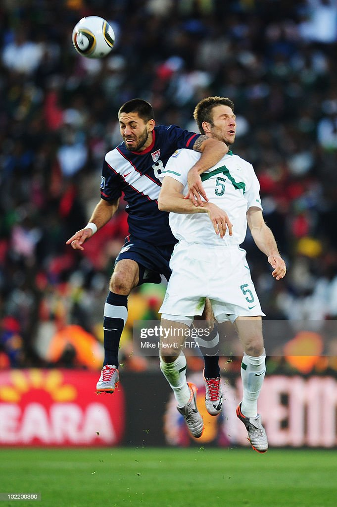 <a gi-track='captionPersonalityLinkClicked' href=/galleries/search?phrase=Clint+Dempsey&family=editorial&specificpeople=547866 ng-click='$event.stopPropagation()'>Clint Dempsey</a> of the United States jumpf for a header with <a gi-track='captionPersonalityLinkClicked' href=/galleries/search?phrase=Bostjan+Cesar&family=editorial&specificpeople=2084483 ng-click='$event.stopPropagation()'>Bostjan Cesar</a> of Slovenia during the 2010 FIFA World Cup South Africa Group C match between Slovenia and USA at Ellis Park Stadium on June 18, 2010 in Johannesburg, South Africa.