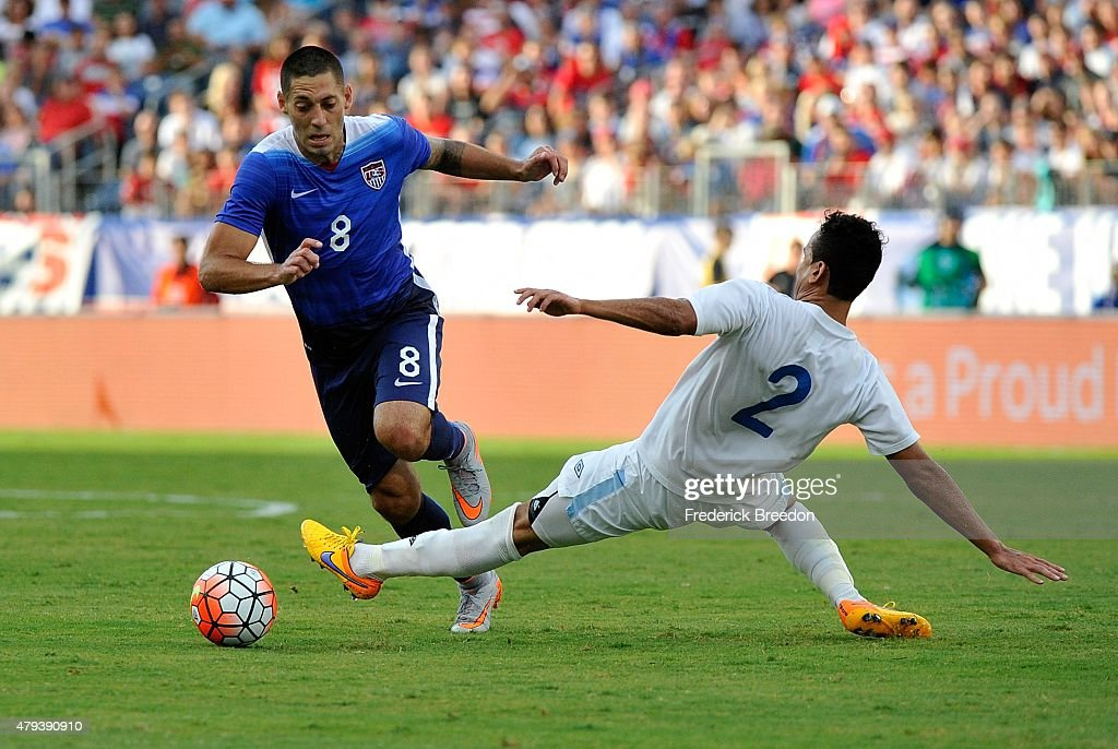 Clint Dempsey of the United States manuevers past Ruben Morales of Guatemala during the first half of an international friendly soccer match at...