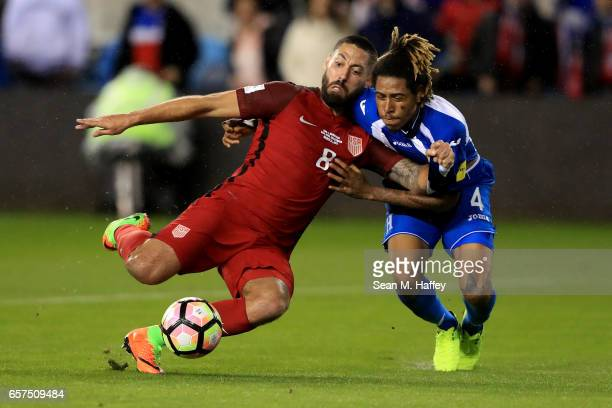 Clint Dempsey of the United States scores a goal as Henry Figueroa of Honduras defends during their FIFA 2018 World Cup Qualifier at Avaya Stadium on...