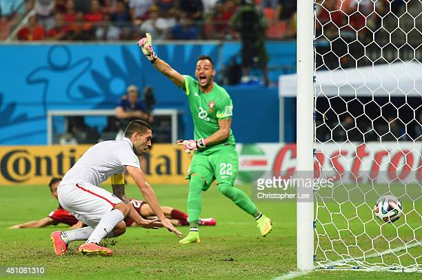 Clint Dempsey of the United States scores his team's second goal past Beto of Portugal during the 2014 FIFA World Cup Brazil Group G match between...