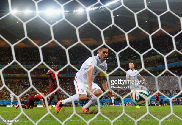 Clint Dempsey of the United States scores his team's second goal during the 2014 FIFA World Cup Brazil Group G match between the United States and...