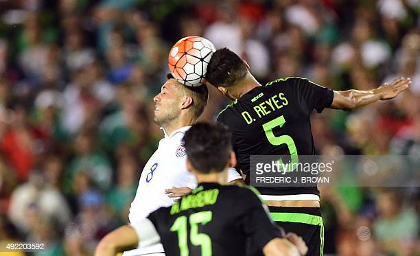 Clint Dempsey of the US vies for the header with Diego Reyes of Mexico during their 2015 CONCACAF Cup match at the Rose Bowl in Pasadena California...