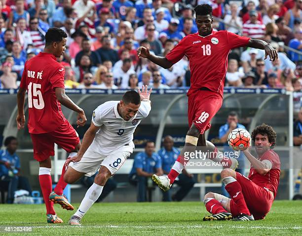 Clint Dempsey of the US vies with Cuba's Adrian Diz Pe Daniel Luis and Jorge Luis Clavelo during a CONCACAF Gold Cup quarterfinal football match in...