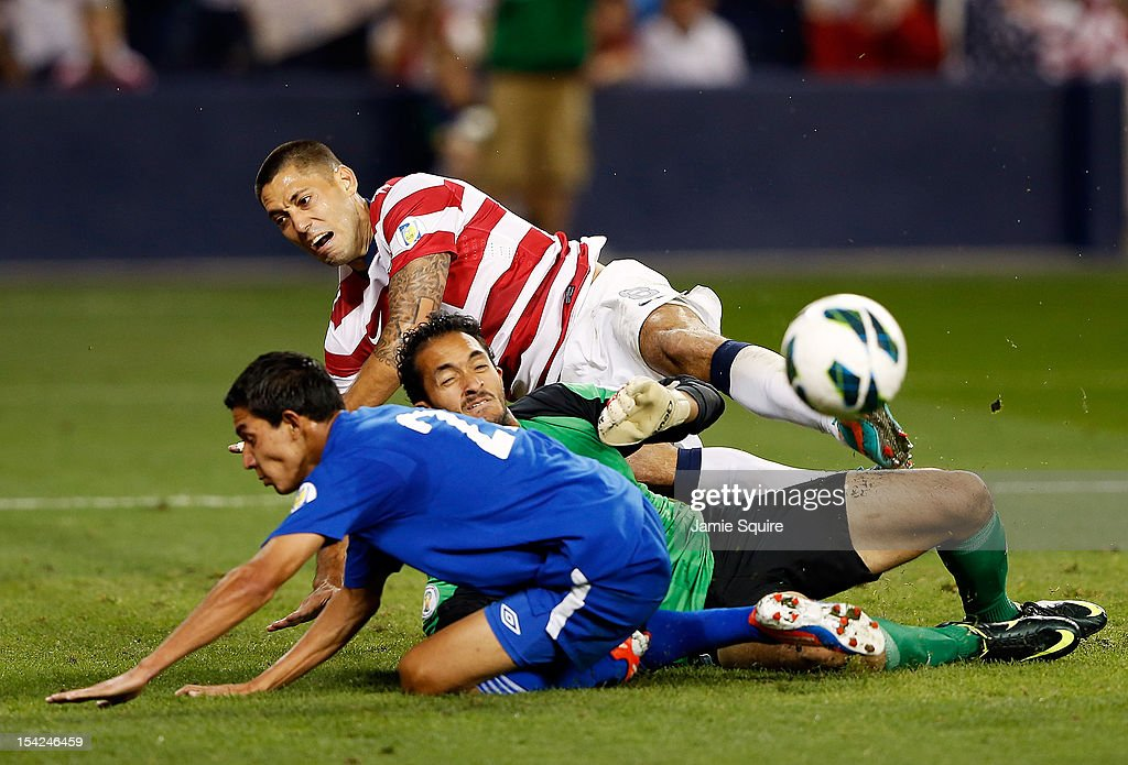 <a gi-track='captionPersonalityLinkClicked' href=/galleries/search?phrase=Clint+Dempsey&family=editorial&specificpeople=547866 ng-click='$event.stopPropagation()'>Clint Dempsey</a> #8 of the USA collides with goalkeeper Ricardo Jerez #1 and defender Jonathan Lopez #23 of Guatemala during the World Cup Qualifying match at LiveStrong Sporting Park on October 16, 2012 in Kansas City, Kansas.