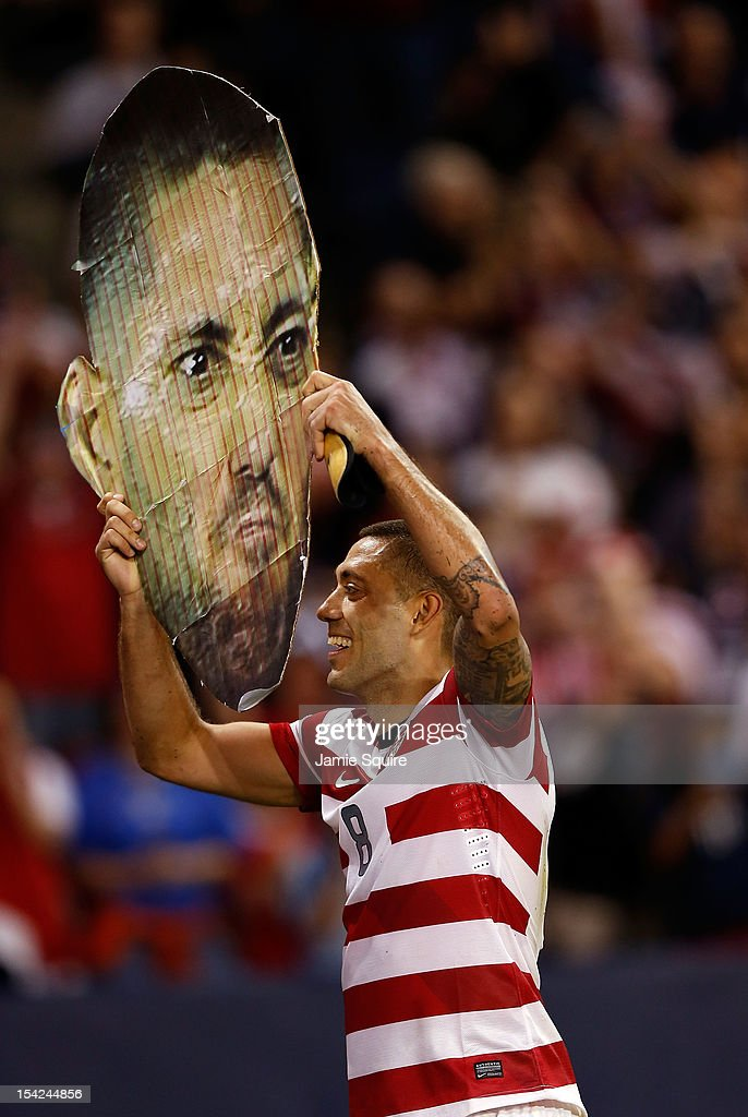 Clint Dempsey #8 of the USA holds up a giant poster of his head after the USA defeated Guatemala 3-1 to win the World Cup Qualifying match at LiveStrong Sporting Park on October 16, 2012 in Kansas City, Kansas.