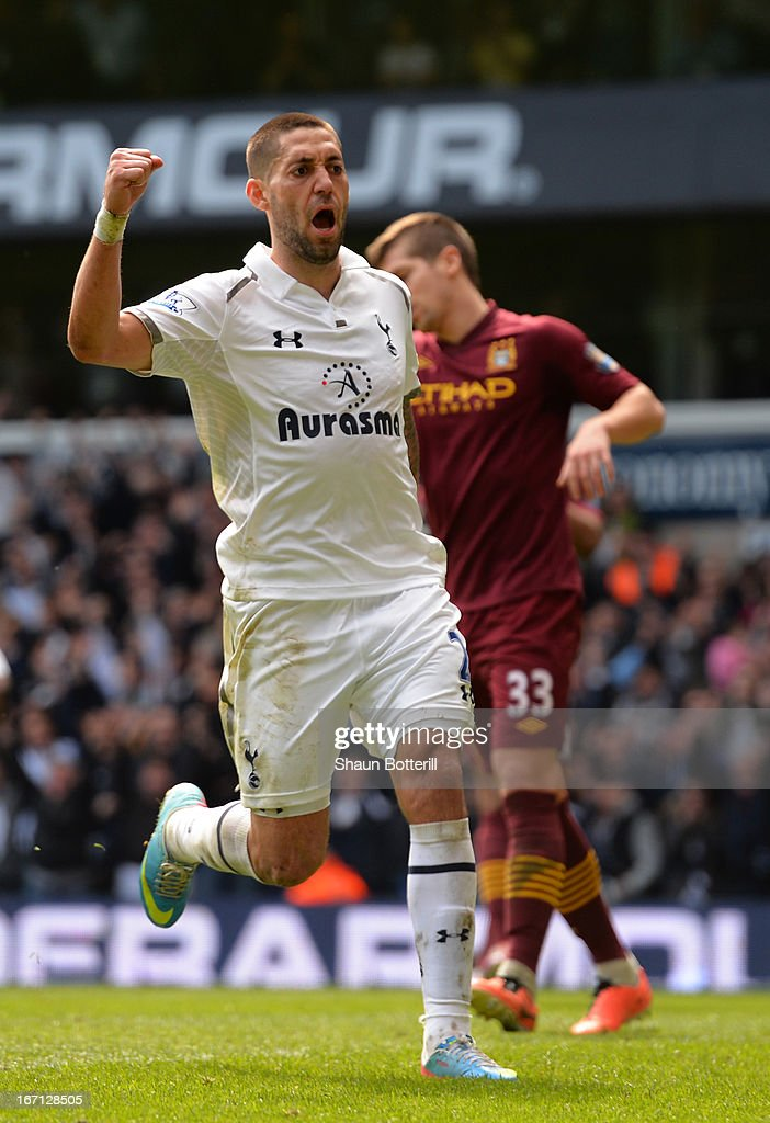 Clint Dempsey of Tottenham Hotspur celebrates scoring their first goal during the Barclays Premier League match between Tottenham Hotspur and Manchester City at White Hart Lane on April 21, 2013 in London, England.