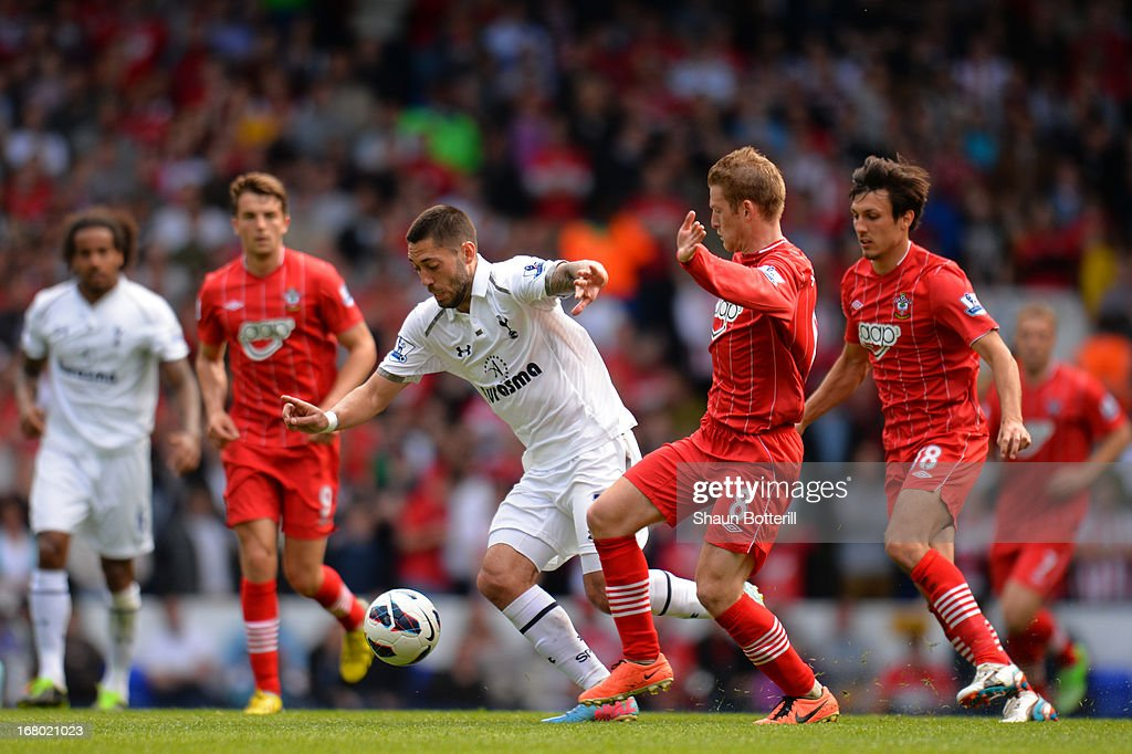 <a gi-track='captionPersonalityLinkClicked' href=/galleries/search?phrase=Clint+Dempsey&family=editorial&specificpeople=547866 ng-click='$event.stopPropagation()'>Clint Dempsey</a> of Tottenham Hotspur is marshalled by <a gi-track='captionPersonalityLinkClicked' href=/galleries/search?phrase=Steven+Davis+-+Northern+Irish+Soccer+Player+-+Born+1985&family=editorial&specificpeople=4175513 ng-click='$event.stopPropagation()'>Steven Davis</a> of Southampton during the Barclays Premier League match between Tottenham Hotspur and Southampton at White Hart Lane on May 4, 2013 in London, England.