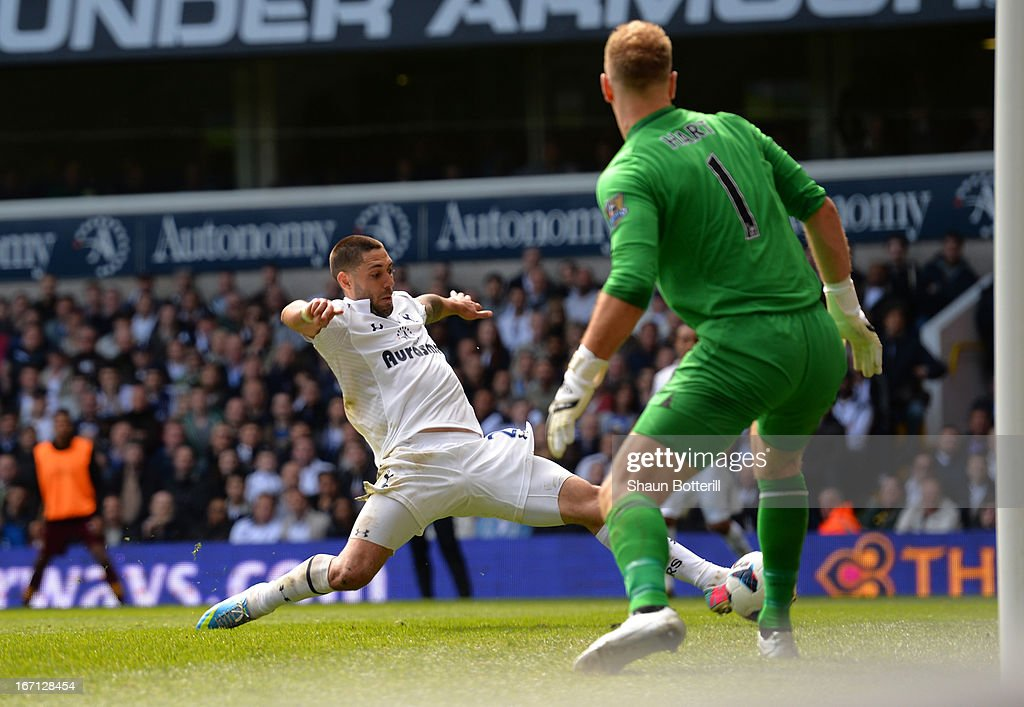 Clint Dempsey of Tottenham Hotspur scores their first goal during the Barclays Premier League match between Tottenham Hotspur and Manchester City at White Hart Lane on April 21, 2013 in London, England.