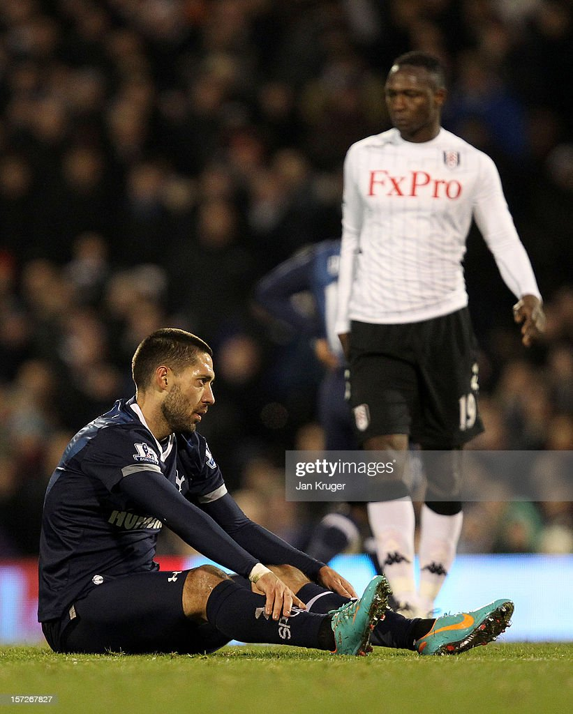 <a gi-track='captionPersonalityLinkClicked' href=/galleries/search?phrase=Clint+Dempsey&family=editorial&specificpeople=547866 ng-click='$event.stopPropagation()'>Clint Dempsey</a> of Tottenham looks on after being fouled by Mahamadou Diarra of Fulham during the Barclays Premier League match between Fulham and Tottenham Hotspur at Craven Cottage on December 1, 2012 in London, England.