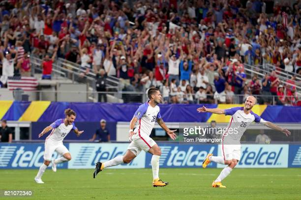 Clint Dempsey of United States celebrates with Graham Zusi of United States and Michael Bradley of United States after scoring against Costa Rica...