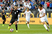 Clint Dempsey of United States dribbles past Oscar Duarte of Costa Rica during a group A match between United States and Costa Rica at Soldier Field...