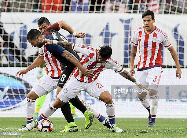 Clint Dempsey of United States is surrounded by Fabian Balbuena Victor Ayala and Gustavo Gomez of Paraguay in the first half during the Copa America...