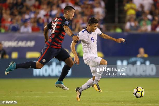 Clint Dempsey of United States of America and Ivan Mancia of El Salvador during the 2017 CONCACAF Gold Cup Quarter Final match between United States...