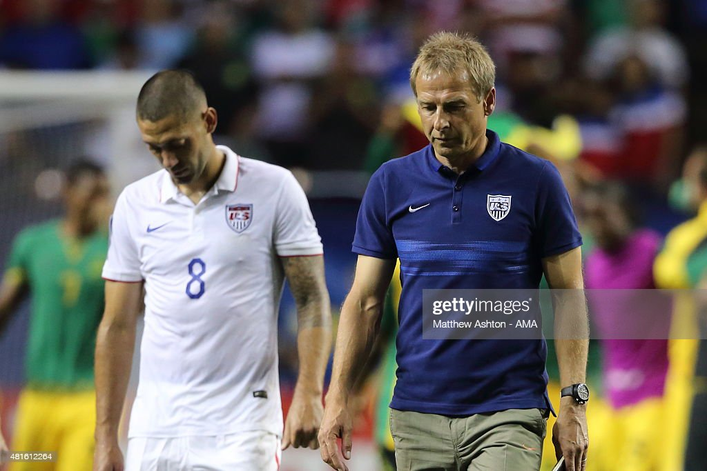 Clint Dempsey of United States of America and Jurgen Klinsmann the head coach / manager of United States of America walk off the field after the 12...