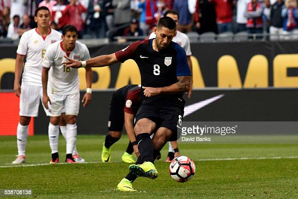Clint Dempsey of United States takes a penalty kick to score the opening goal during a group A match between United States and Costa Rica at Soldier...