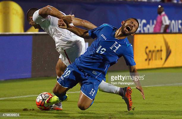 Clint Dempsey of USA battle for control of the ball against Alfredo Mejia of Honduras during the 2015 CONCACAF Gold Cup Group A match between USA and...