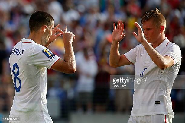 Clint Dempsey of USA celebrates a second half goal with teammate Aron Johannsson against Cuba during the second half of USA's 60 win during the 2015...