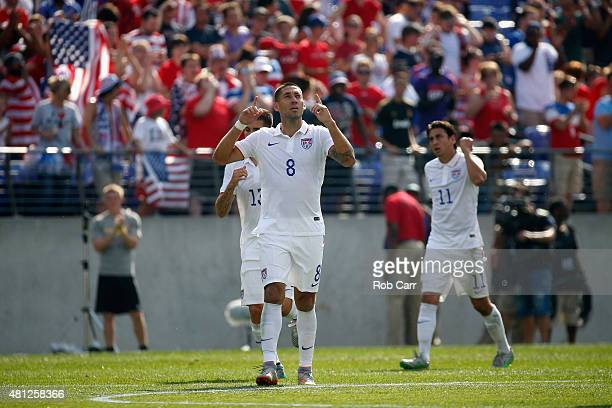 Clint Dempsey of USA celebrates after scoring a first half goal against Cuba during the 2015 CONCACAF Gold Cup quarterfinal match at MT Bank Stadium...