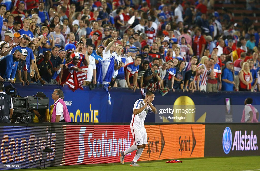 <a gi-track='captionPersonalityLinkClicked' href=/galleries/search?phrase=Clint+Dempsey&family=editorial&specificpeople=547866 ng-click='$event.stopPropagation()'>Clint Dempsey</a> #8 of USA celebrates with fans after USA beat Honduras 2-1 during the 2015 CONCACAF Gold Cup Group A match between USA and Honduras at Toyota Stadium on July 7, 2015 in Frisco, Texas.