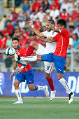Clint Dempsey of USA competes for the ball during an international friendly match between Chile and USA at El Teniente Stadium on January 28 2015 in...