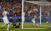 Clint Dempsey of USA scores against Donis Escober of Honduras during the 2015 CONCACAF Gold Cup Group A match between USA and Honduras at Toyota...
