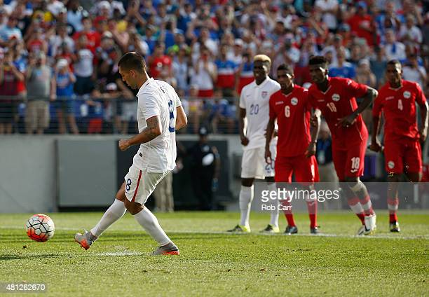 Clint Dempsey of USA scores on a penalty kick against Cuba during the second half of USA's 60 win during the 2015 CONCACAF Gold Cup quarterfinal...