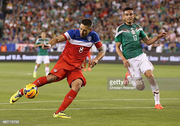 Clint Dempsey of USA shoots the ball past Jesus Eduardo Zavala of Mexico during the first half of the International Friendly at University of Phoenix...