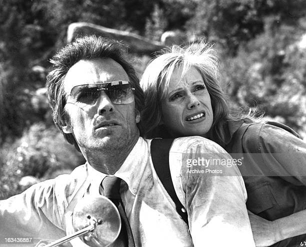 Clint Eastwood and Sondra Locke looking from motor bike in a scene from the film 'The Gauntlet' 1977