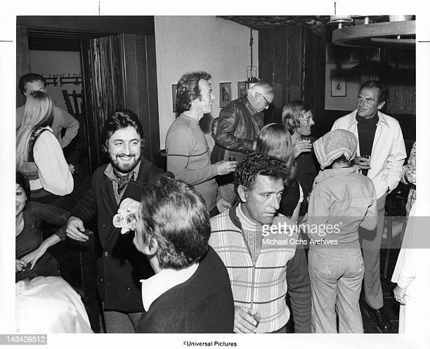 Clint Eastwood at a party having a drink and mingling in a scene from the film 'Coogan's Bluff' 1968