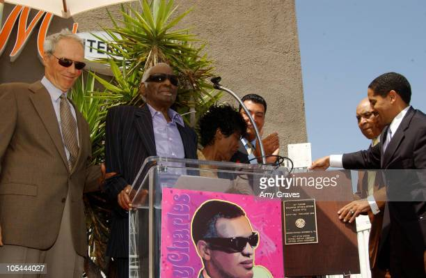Clint Eastwood Cicely Tyson Joe Adams and Martin Ludlow stand with Ray Charles as he speaks at the unveiling of the plaque which dedicates The Ray...