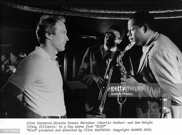 Clint Eastwood directing Samuel E Wright and Forest Whitaker in between scenes from the film 'Bird' 1988