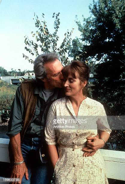Clint Eastwood kissing Meryl Streep on the cheek as she nestles into him in a scene from the film 'The Bridges of Madison County' 1975